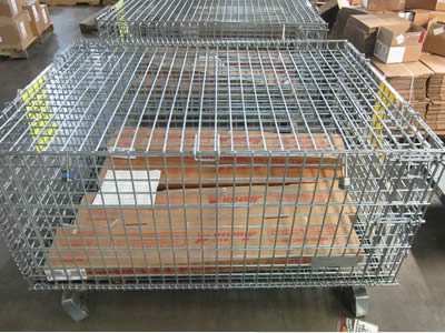 A big size square stainless steel welded mesh basket on the floor and some folding cartons at the bottom.
