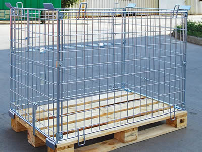 A medium stainless steel welded mesh container with a wooden bottom put on the floor.