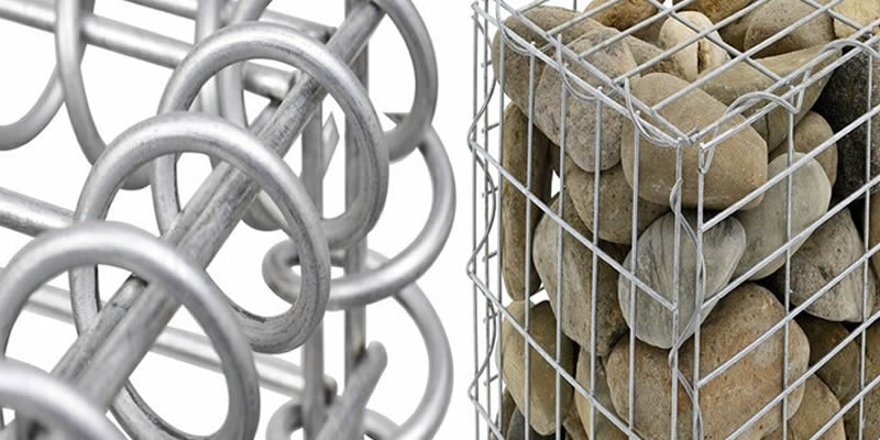 The corner of a stainless steel welded mesh gabion basket and a more clear detail.