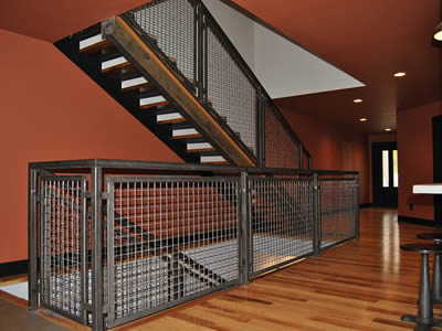 Two parallel stairs up and down between two floors, the stair's fence is stainless steel welded mesh with bright surface.