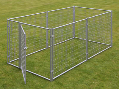 A big rectangle stainless steel welded mesh kennel is on the green grass, it is made up with seven panels, and the door is open.