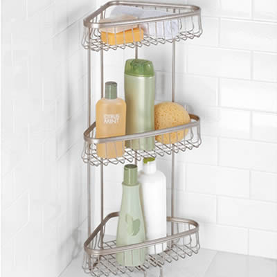 A three-tier shower shelf made of stainless steel welded mesh stand at the corner, some commodity put on it.