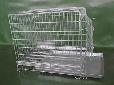 A small size stainless steel welded mesh pet cage put on the floor, the door is open and the stainless steel bottom can pull out.