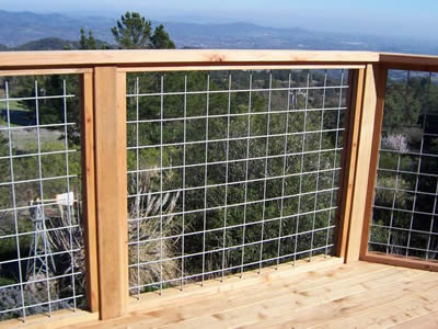 At view area, the deck fencing framework is wood, the rest is stainless steel welded mesh.